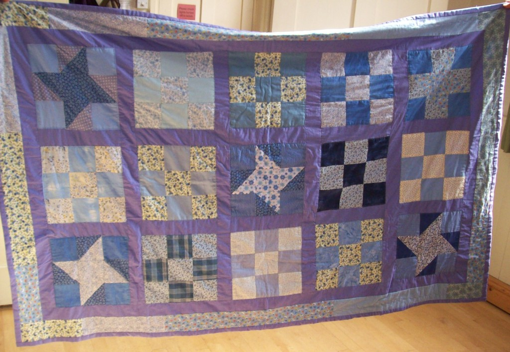 A quilt for the refuge. Sue has just put in the last stitches.