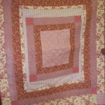 A medallion quilt. The real thing has much more vibrant colours.