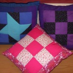 We made cushions from spare blocks that didn't get used in the quilts.