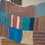 A blanket made on a peg loom and donated by a friend [not member] of the group.