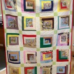 A children's quilt. The cats came from some old curtain material.